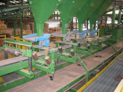 Slider-bed belt conveyor and sand application line.