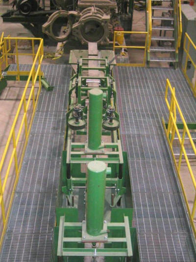 Clay brick extrusion line - texturing, logo and slurry application with related platforms and walkways.