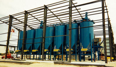 Seven 100 ton silos with belt feeders for clay and clay products