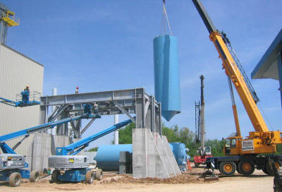 Turnkey silo support structure and four 200 ton capacity frac sand silos in a seismic 3 zone.