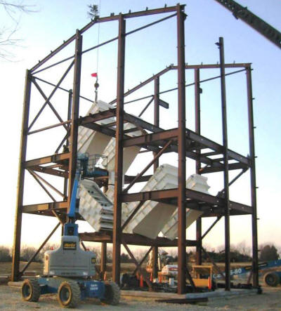 Four, triple 5'x10' over triple 5'x10' screens and related equipment in a custom screen tower structure for a frac sand plant.
