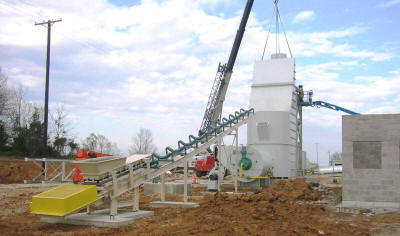 Inclined trough belt conveyor feeding into a Stark Fluid Bed Dryer at a frac sand plant.