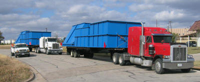Hauling prefabricated modules for eight 150 ton capacity clay storage silos for a brick manufacturing plant.
